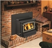This wood insert sits on the fireplace hearth to provide convective and radiant heat.